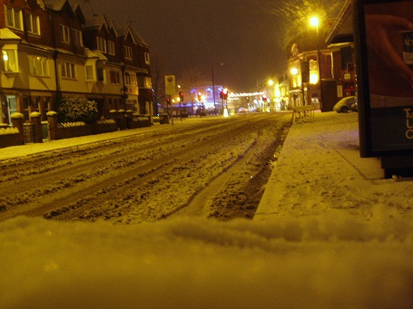 Lindon road covered in snow at night